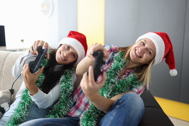 Woman hold joystick in hand and lean to side. Premium Photo