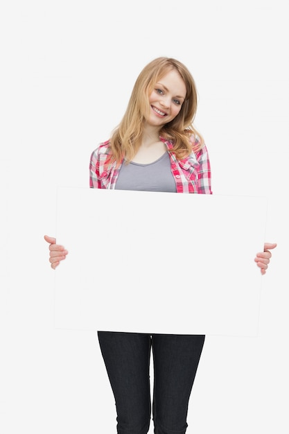 Woman holding a blank board Premium Photo