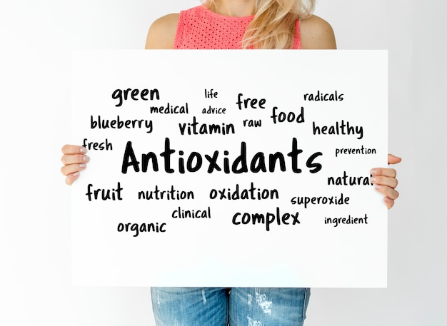 Woman holding a board with Antioxidants concept Free Photo