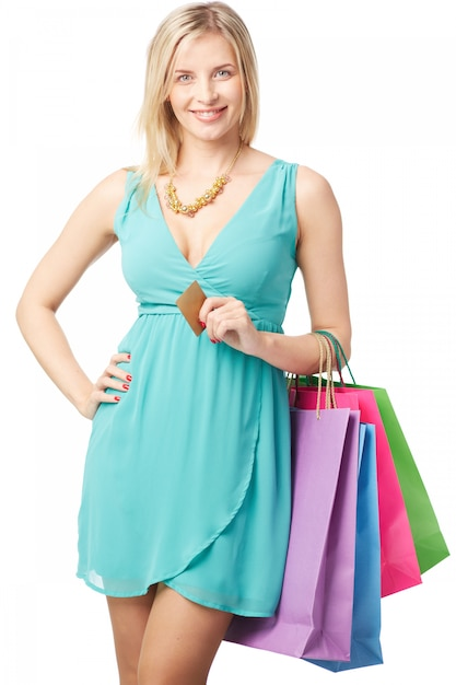 woman holding a credit card and shopping bags photo free download