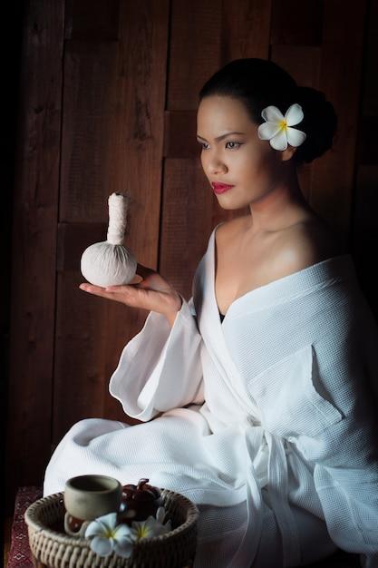 Woman holding a massager Free Photo