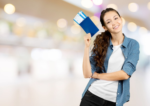 Woman holding  air ticket isolated Premium Photo