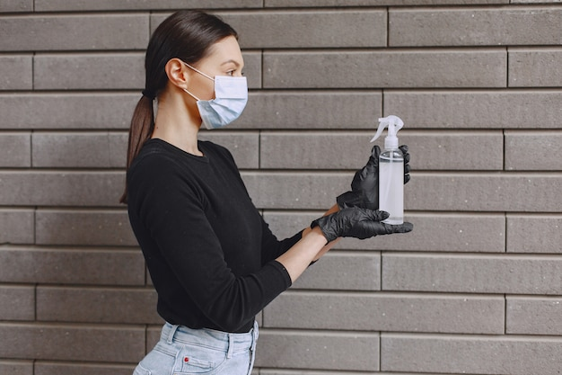 Woman holding antiseptic in her hands Free Photo