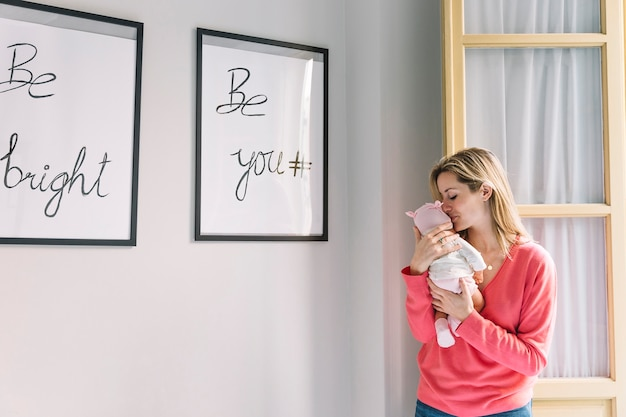 Woman holding baby and frames with quotes Photo   Free Download