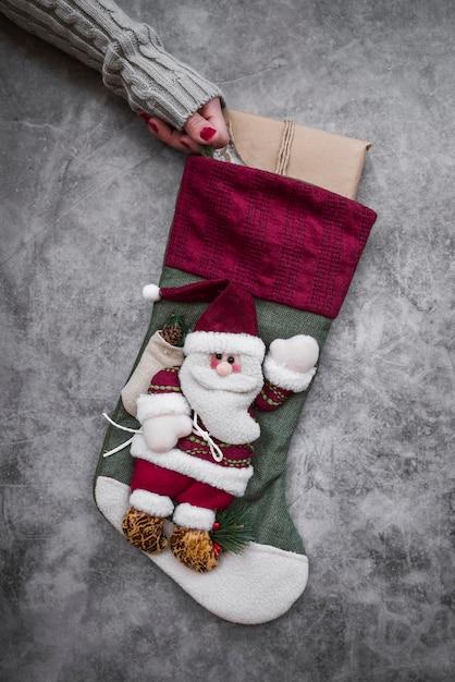 Woman holding big christmas sock Free Photo