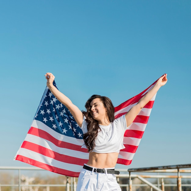 Woman holding big usa flag Free Photo