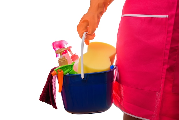 Woman holding a bucket full of cleaning supplies isolated on white background Premium Photo