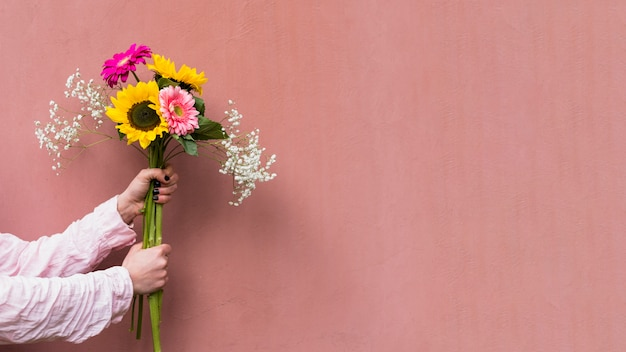 Woman holding bunch of fresh flowers Free Photo