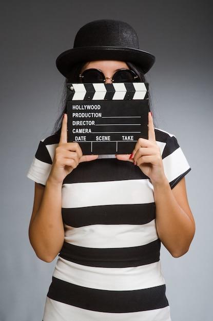 Woman holding a chalkboard Premium Photo