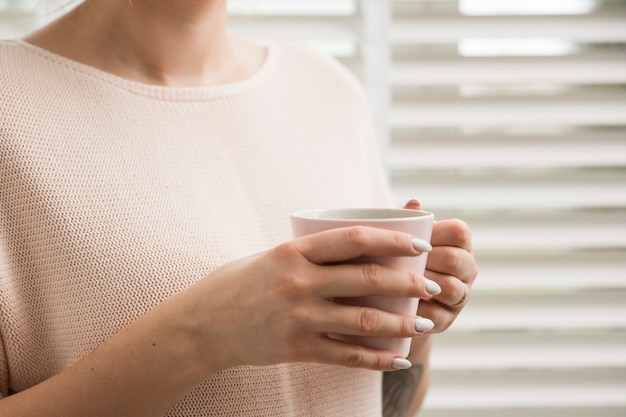 Woman holding coffee mug Free Photo