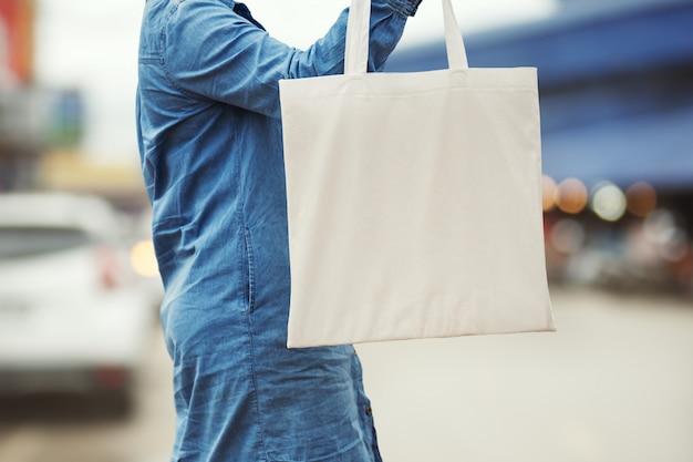 Woman holding cotton bag for shopping. eco concept Premium Photo