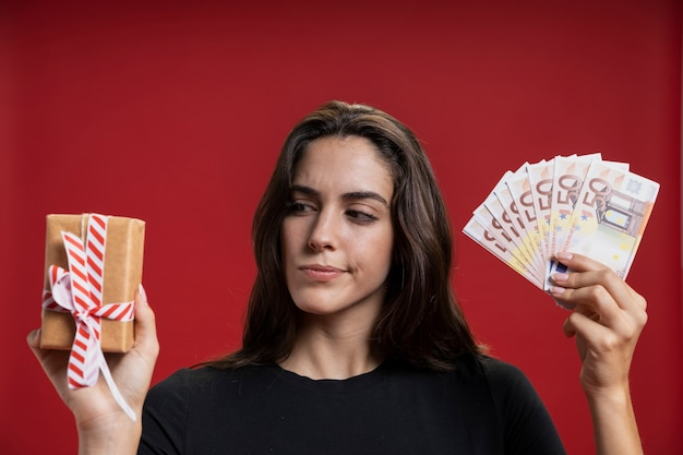 Woman holding credit cards and gift Free Photo