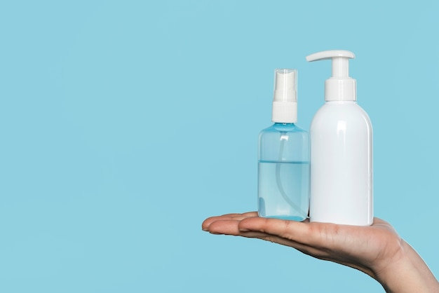 Woman holding disinfectant bottles Free Photo