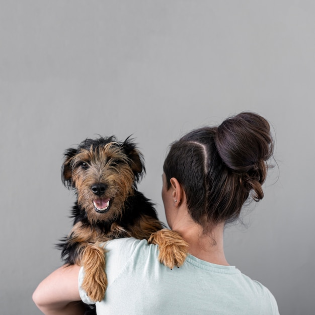 Woman holding dog with copy-space Free Photo