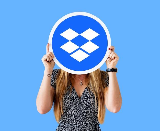 Woman holding a dropbox logo icon Free Photo