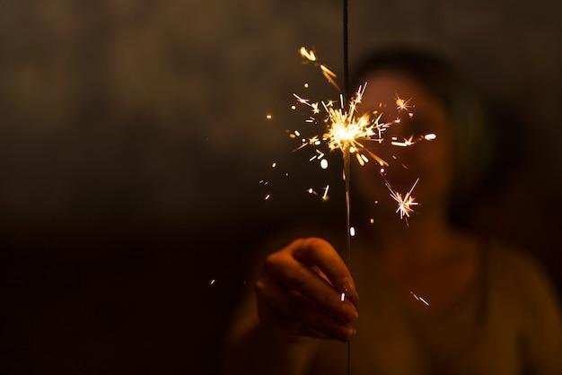 Woman holding flaming bengal light Free Photo