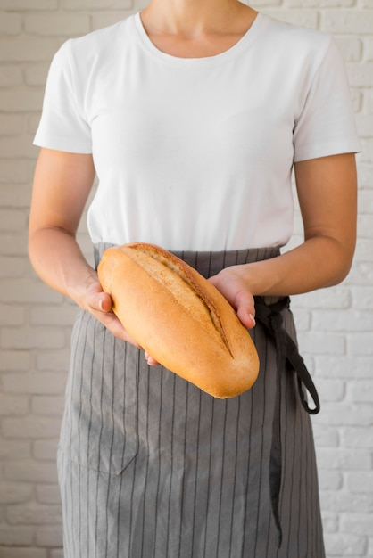 Woman holding fresh baguette Free Photo