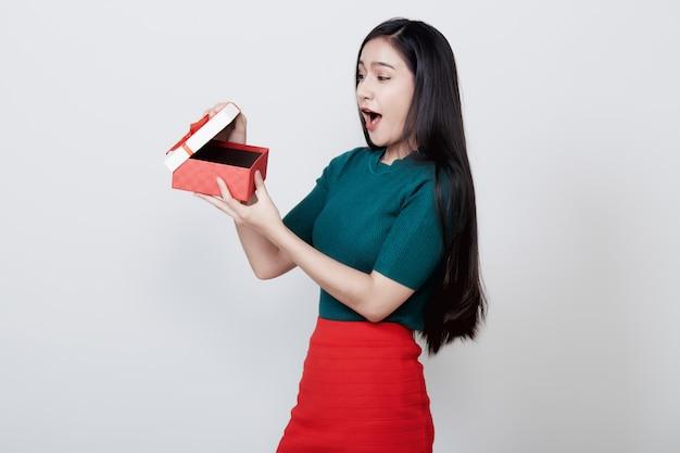 Woman holding gift box christmas on white Premium Photo