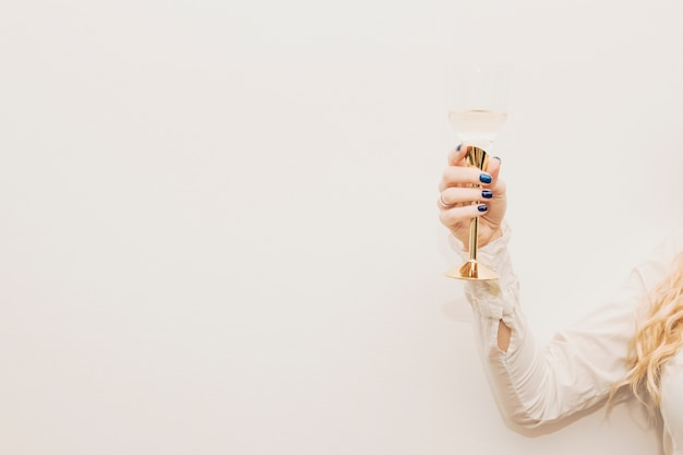 Woman holding glass of champagne Free Photo