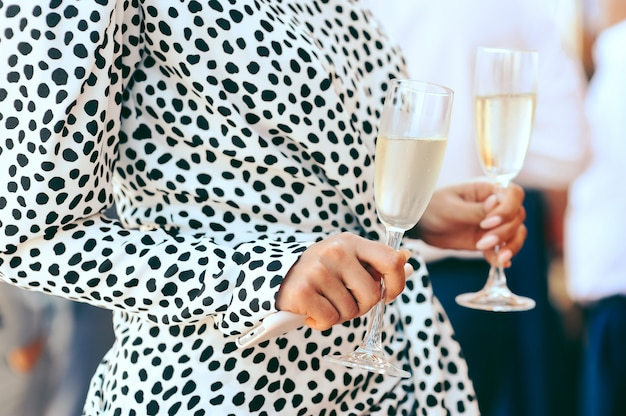 Woman holding goblets with champagne Free Photo