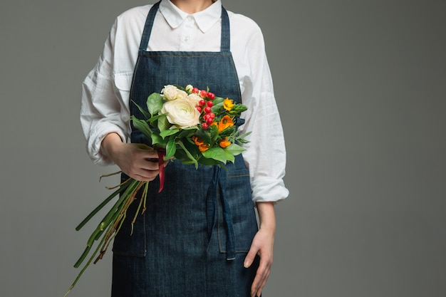 Woman holding a gorgeous bouquet Free Photo