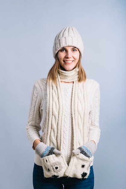 Woman holding hands in scarf pockets Free Photo