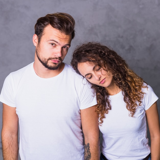 Woman holding head on man shoulder Free Photo