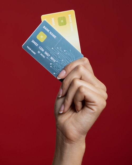 Woman holding her credit cards close-up Free Photo