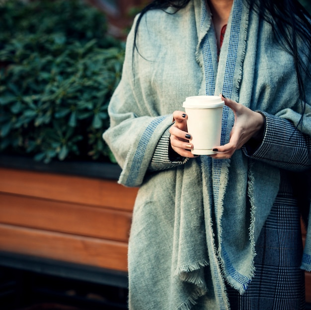 Woman holding in her hands a cup of coffee 1 Free Photo