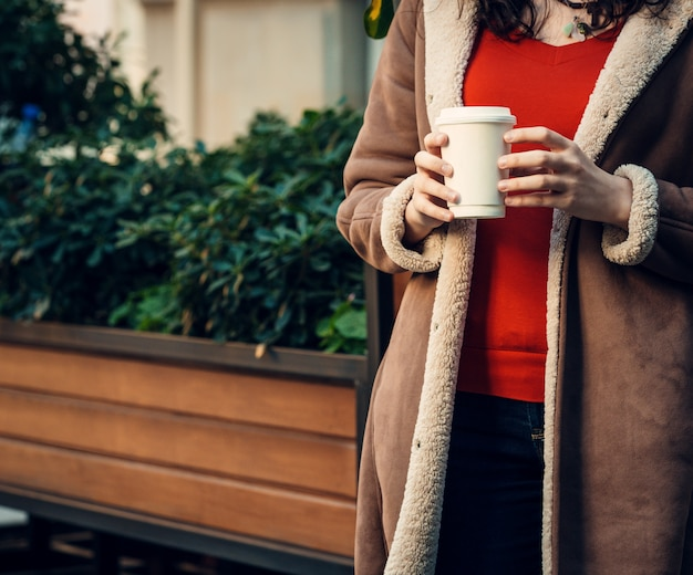 Woman holding in her hands a cup of coffee Free Photo