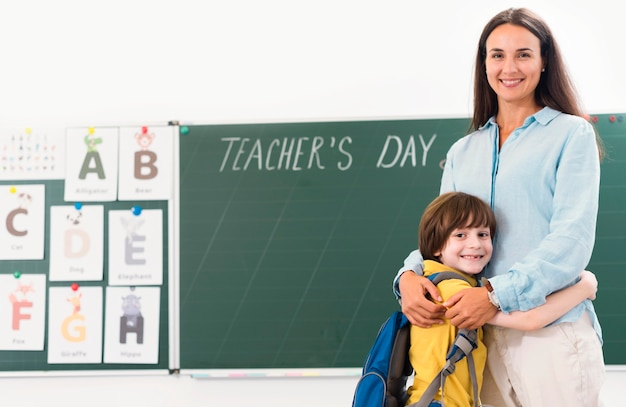 Woman holding her student with copy space Premium Photo