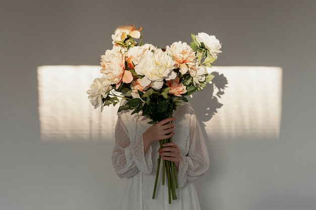 Woman holding huge flower bouquet Premium Photo