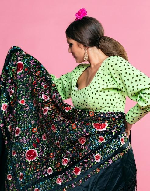 Woman holding manila shawl gracefully Free Photo