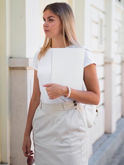Woman holding a mock-up magazine Free Photo