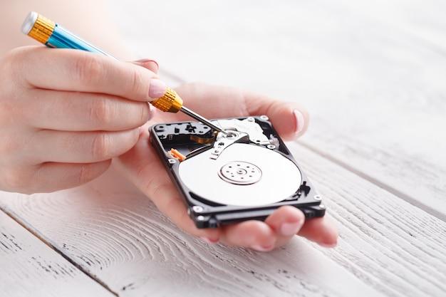 Woman holding open hard disk Premium Photo