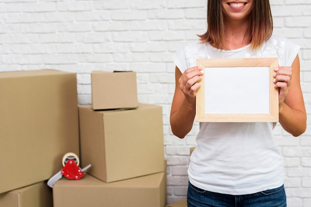 Woman holding a photo frame mock-up Free Photo