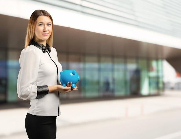 Woman holding a piggy bank Premium Photo