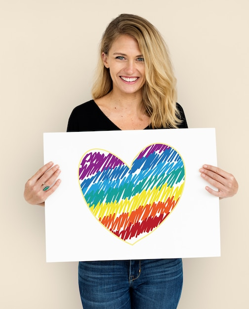 Woman holding placard with lgbt heart icon Premium Photo