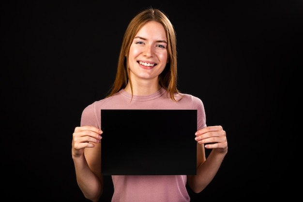 Woman holding a poster mock-up Free Photo