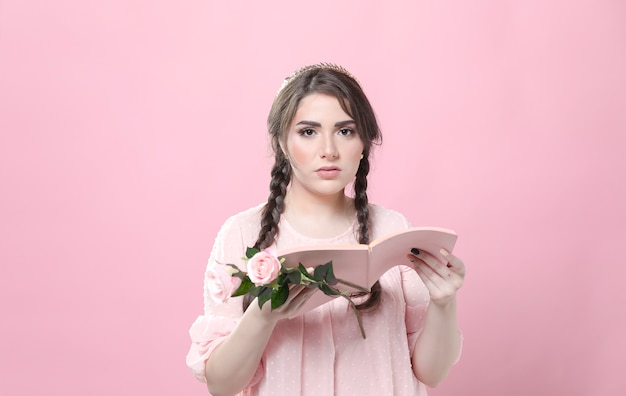 Woman holding roses not impressed by book Free Photo