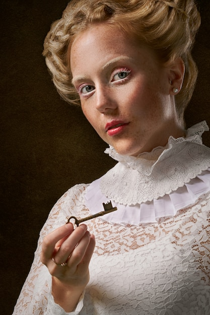 Woman holding skeleton key Free Photo