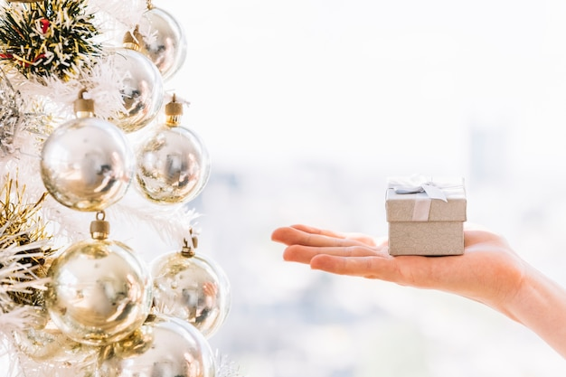 Woman holding small gift box in hand Free Photo