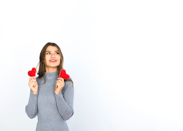 Woman holding small hearts in hands Free Photo
