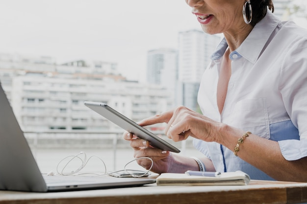 Woman holding a tablet in her office Free Photo