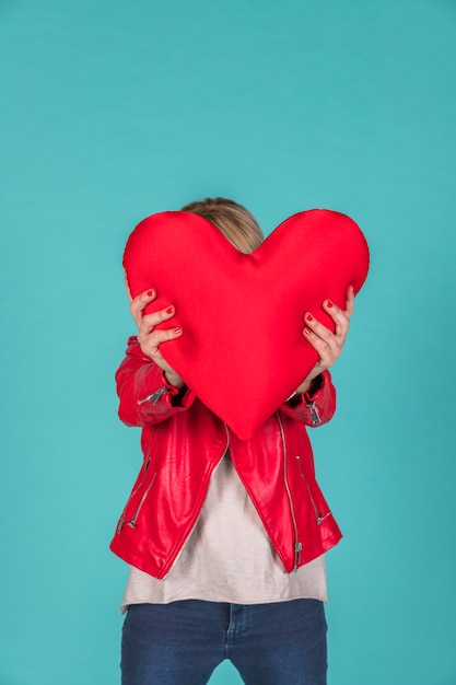 Woman holding toy symbol of heart Free Photo
