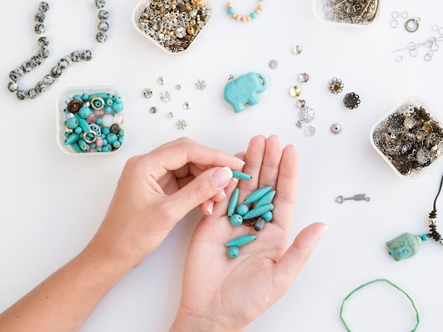 Woman holding turquoise colored stones Free Photo