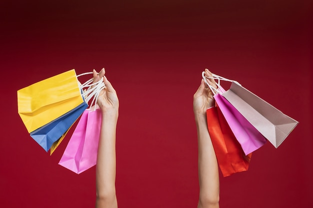 Woman holding up her shopping bags close-up Free Photo