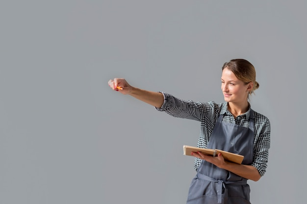 Woman holding up pencil with copy space Free Photo