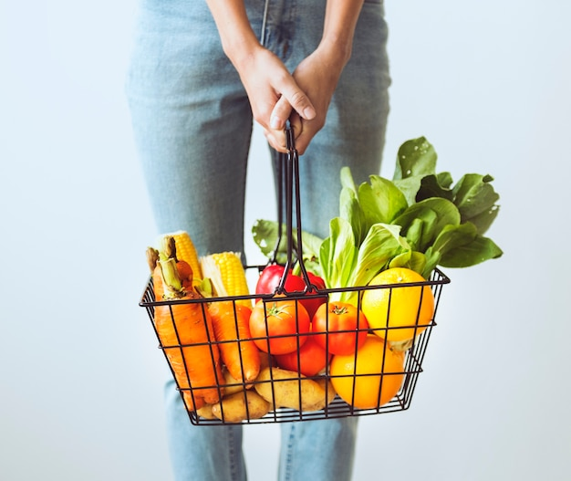 Woman holding vegetable basket Free Photo