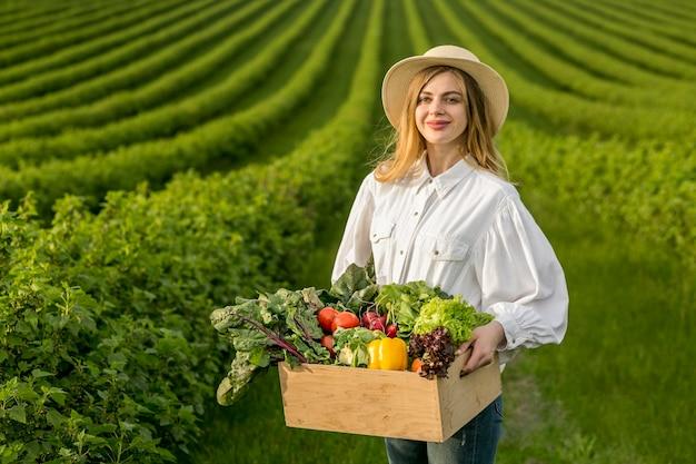 Woman holding vegetables basket Premium Photo